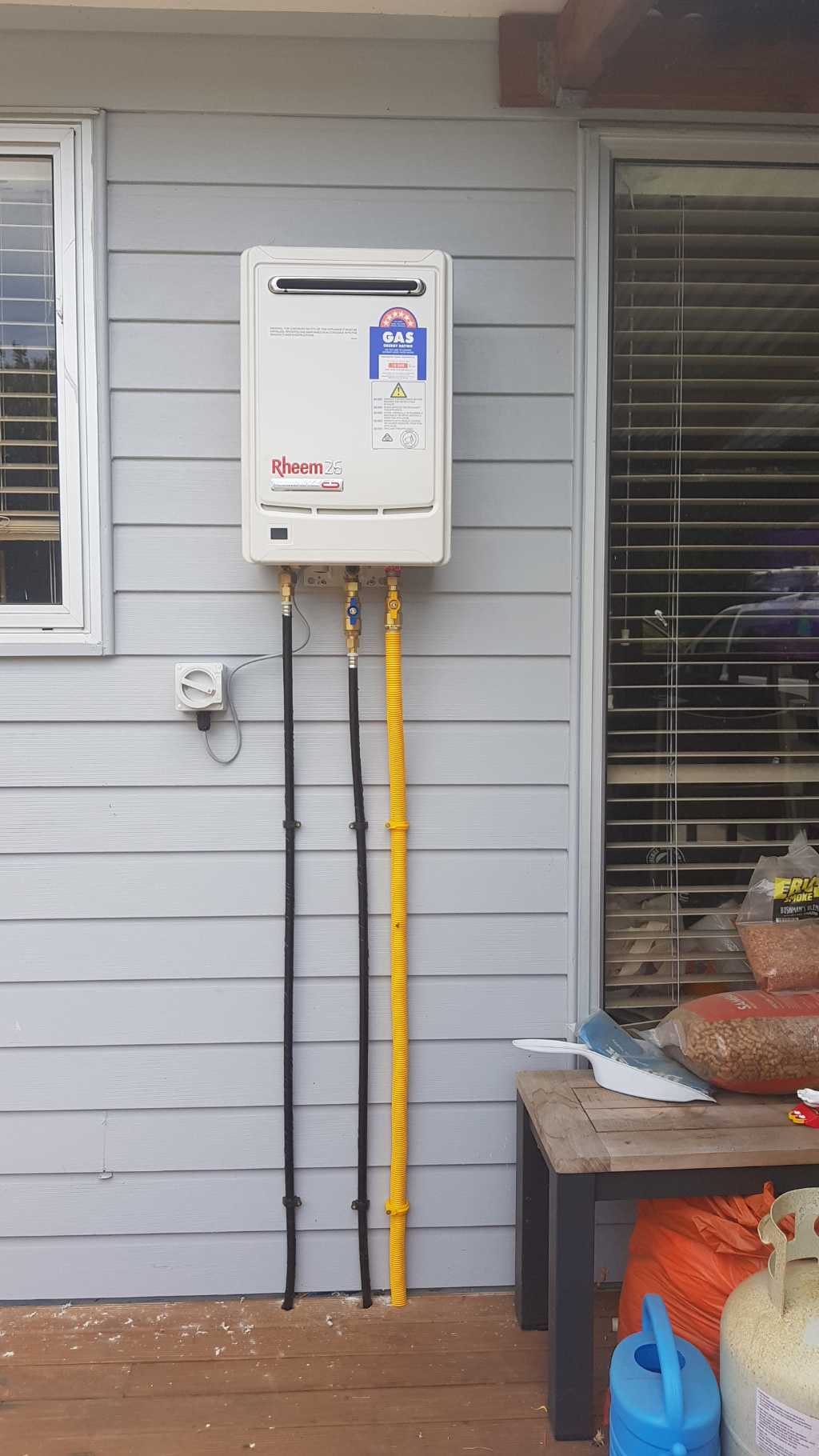 Outdoor Rheem continuous flow mains water heater